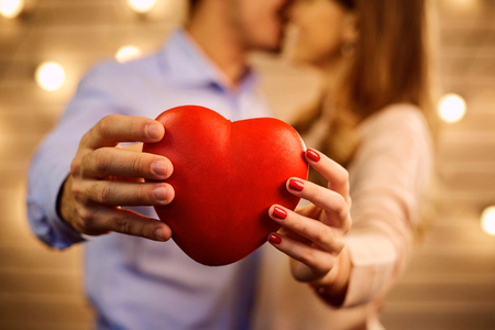 Heart in the hands of a young couple close-up. Concept Valentines Day. Stock Photo