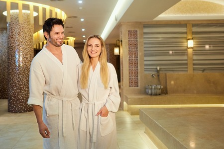 A couple in the bathrobes at the spa is resting. Stock Photo