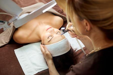 Cosmetologist dermatologist makes a woman a procedure bio oxidation therapy. Stock Photo