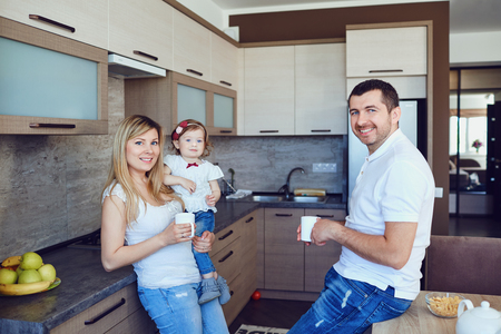 Portrait of a happy family in the kitchen. Stock Photo