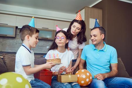 Happy Family celebrates birthday with a birthday cake. Stock Photo
