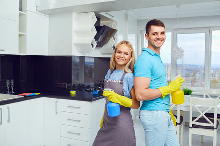 House cleaning. A young couple is cleaning an apartment.