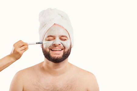A funny man in a face mask in a beauty salon.