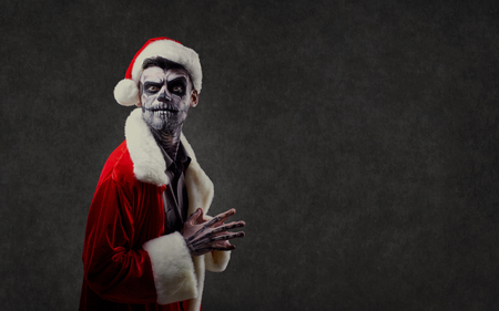 Santa Claus is a wizard with a skull on Christmas against the background of the corpsepice.