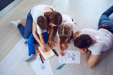 Top view of family drawing on the floor.