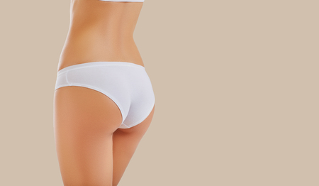 Close up of womans  buttocks in underwear. Womans body from behind.