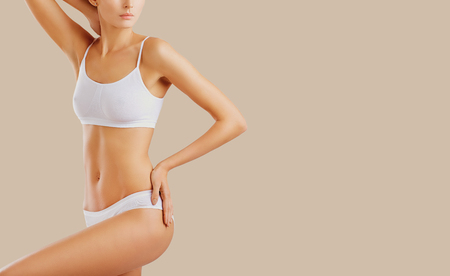 Aesthetic slim body of a woman in underwear. Body care. Stock Photo