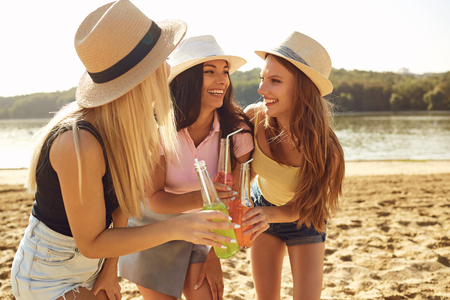 Girlfriends at a party on the beach in a park in the summer, autumn. Stock Photo