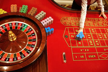 Roulette at the casino. The table is red for playing roulette.Casino concept. 스톡 콘텐츠