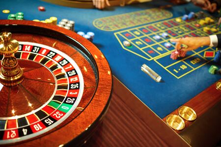 Roulette with players at the table in a casino. Casino concept. 스톡 콘텐츠