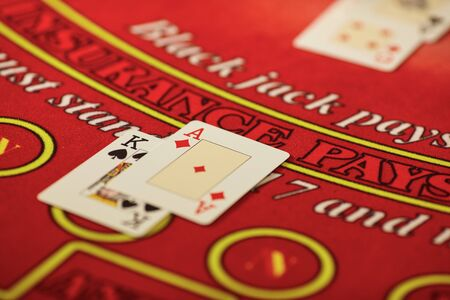 The croupier in the casino does a shuffle of cards at the table. Gambling