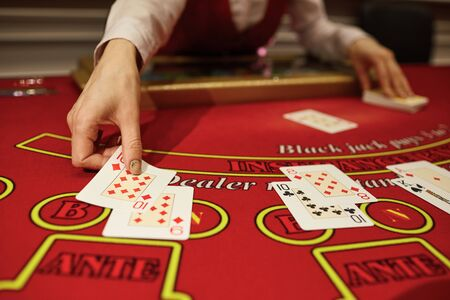 The croupier in the casino does a shuffle of cards at the table. Gambling 스톡 콘텐츠 - 125338117