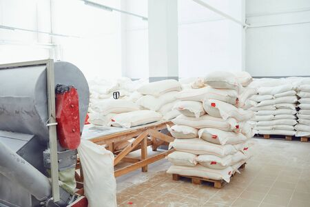 Bags of flour in the warehouse of the factory.