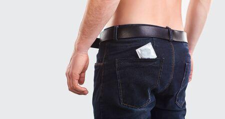 Condom in the pocket of men jeans.