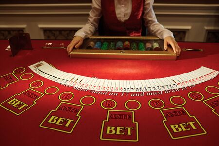The croupier in the casino does a shuffle of cards at the table. Gambling 스톡 콘텐츠