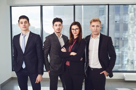 Group of young business people standing at office. Stockfoto
