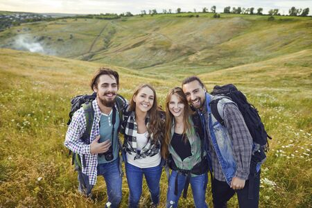 Friends hikers smiling at camping trip in nature Stockfoto