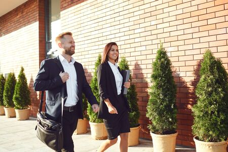 Business People walk along the city street. Concept success business meeting work professional. Stockfoto