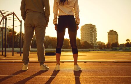 Athletic couple in the morning at the stadium. Jogging during training.Jogging. Health. Healthy lifestyle. Stockfoto