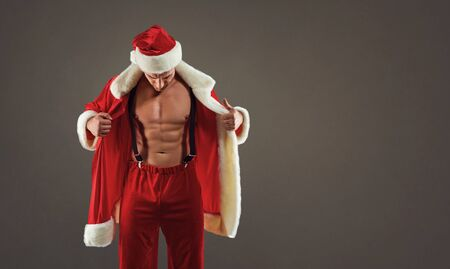 Santa with an athletic body on the gray background. Stok Fotoğraf