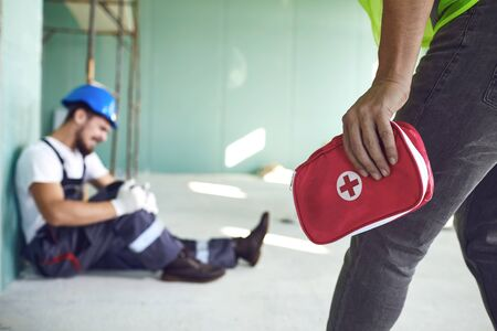 Construction worker accident with a construction worker. First aid for injury at work.