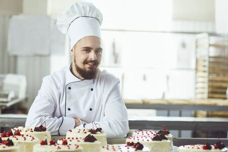 Pastry man smiling in a pastry shop.