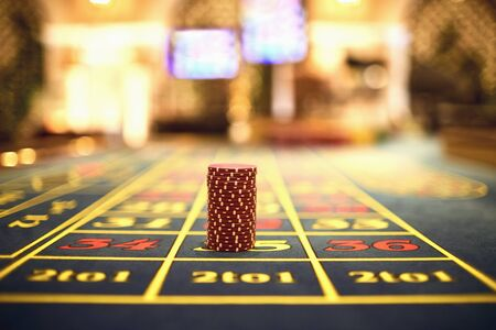Roulette chips on a gaming table in a casino. Casino game concept.