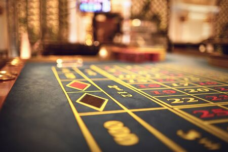 Casino roulette table background. Gambling in a casino. 스톡 콘텐츠