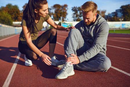 Knee injury in training. A male injured his leg during exercise. Injury while running. Knee pain.