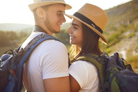 Couple with backpacks on hikking the nature. Travel,tourism,people,backpack concept