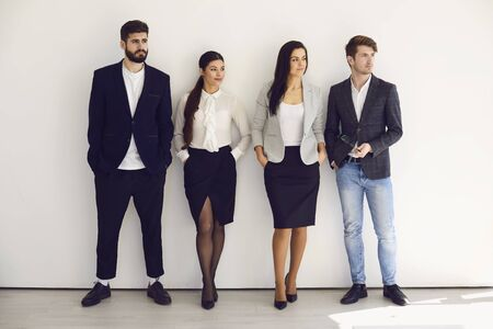 Group of young business people team standing teamwork on the background. Concept meeting businessmen business women analytics startup idea strategy team.