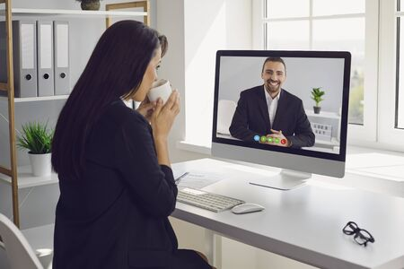 Online work video chat conference. Business woman talking listening working learning video chat online internet video call application webcam business communication freelancer sitting at the table in the living room at office home.