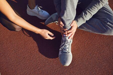 Knee injury in training. Man injured his leg during exercise. Injury while running. Knee pain.