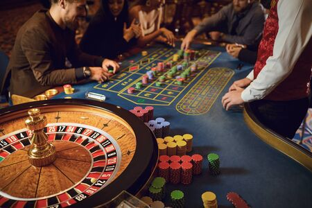 Hand of a croupier on a roulette whell in a casino. Roulette betting poker. Gambling in a casino.