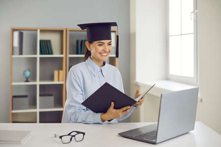 Getting degree online. Happy student graduating from business school, college or university. Smiling woman sitting at laptop computer and presenting course work, thesis or dissertation via video call