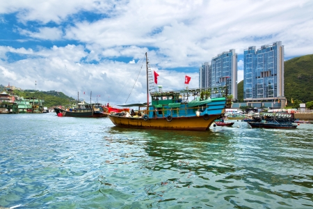 Famous floating village in Aberdeen is an area and town on the south shore of Hong Kong Island on July 2  2013 in Hong Kong
