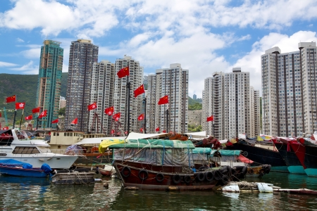 Bay. Famous floating village in Aberdeen is an area and town on the south shore of Hong Kong Island on July 2  2013 in Hong Kong. photo