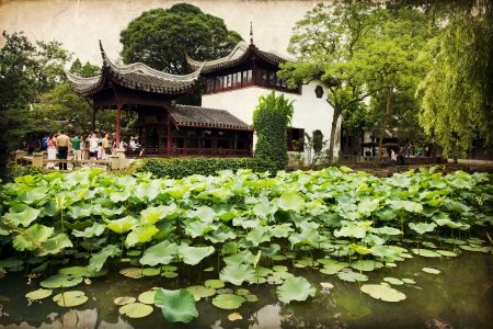 Chinese classical garden with pavilions and pond in Suzhou, China