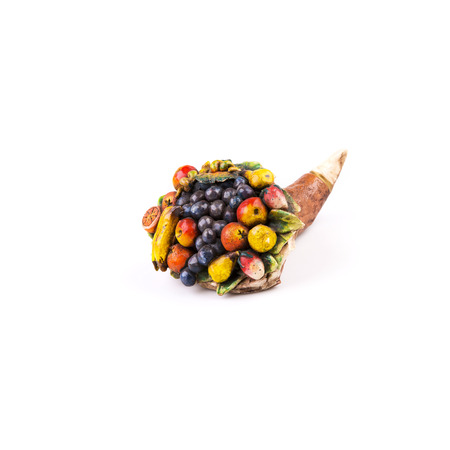 Ceramic cornucopia with fruits on white background photo