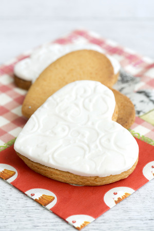 sugar paste: Shortbread cookies in the shape of heart decorated with sugar paste