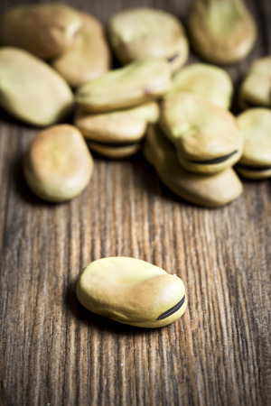 Beans on wooden background, macro, focus selected photo