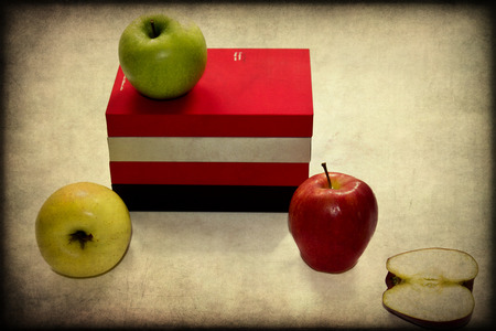 Fresh Green, Yellow and Red Apples Isolated on an open book photo