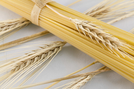 Spaghetti, Italian pasta, with ear of wheat Stock Photo