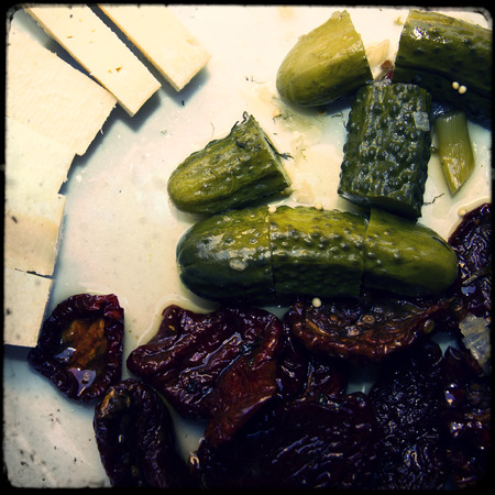 Appetizer consisting of dried tomato, cheese and cucumber photo