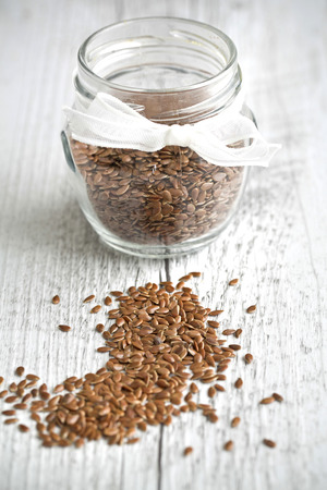 common flax:  Flaxseed, Linum usitatissimum, common flax on a wooden background