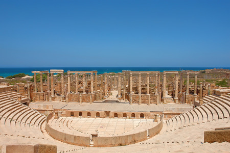 The Theater at the spectacular ruins of Leptis Magna near Al Khums, Libya Фото со стока