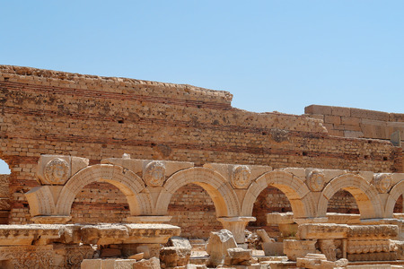stone arches: Libya Tripoli Leptis Magna Roman archaeological site -stone arches with carved figures of medusa or gorgon heads
