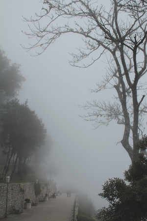 Fog in Erice, Castle of Venus, Trapani, Sicily, Italy photo
