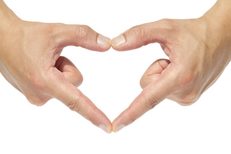 Hands in the form of heart isolated on white  photo