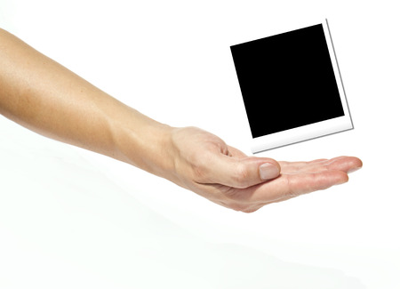 Holding Instant photo on a white background photo